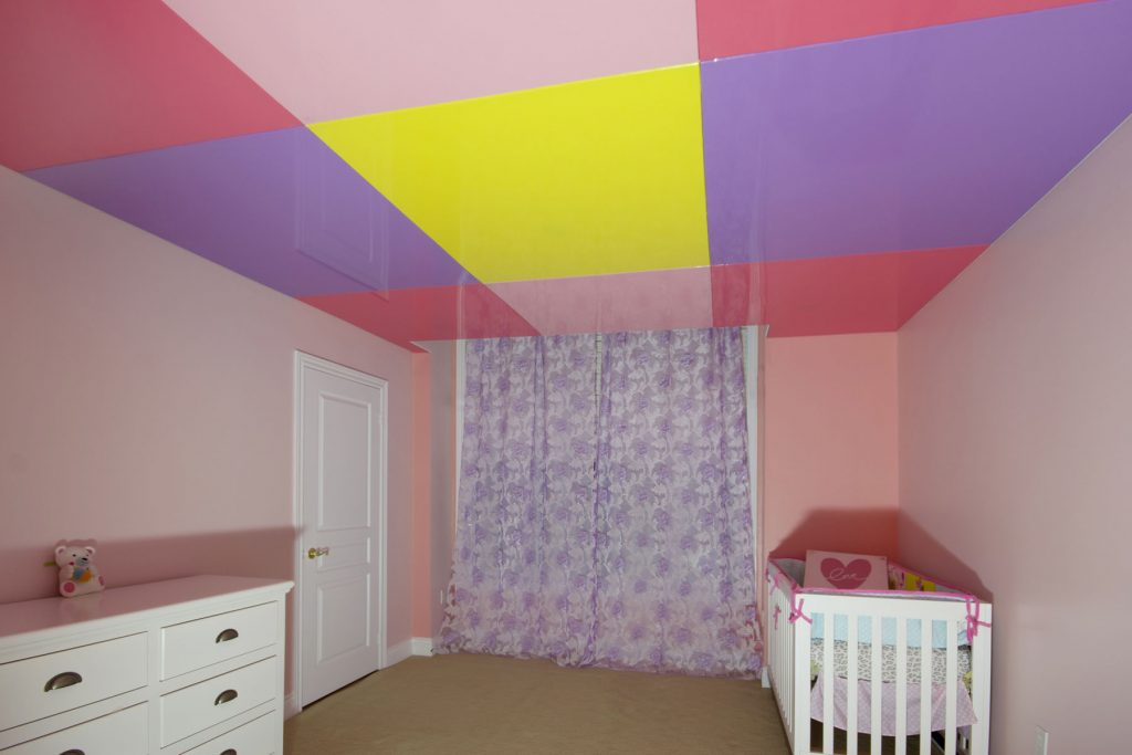 multi color high gloss stretch ceiling in pink kids room