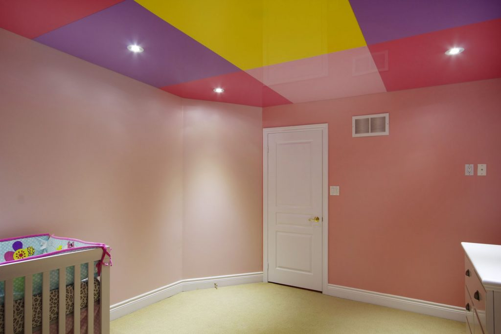 kids room with multi color stretch ceiling glossy