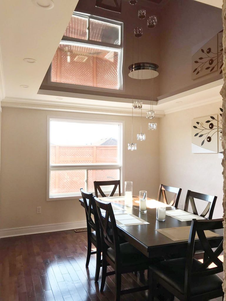 modern dining room with stretch ceiling mirror effect by laqfoil Delhi