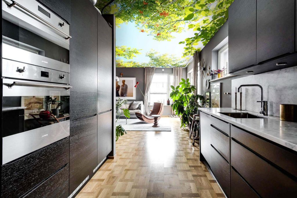 modern kitchen with back lit printed ceiling Indonesia