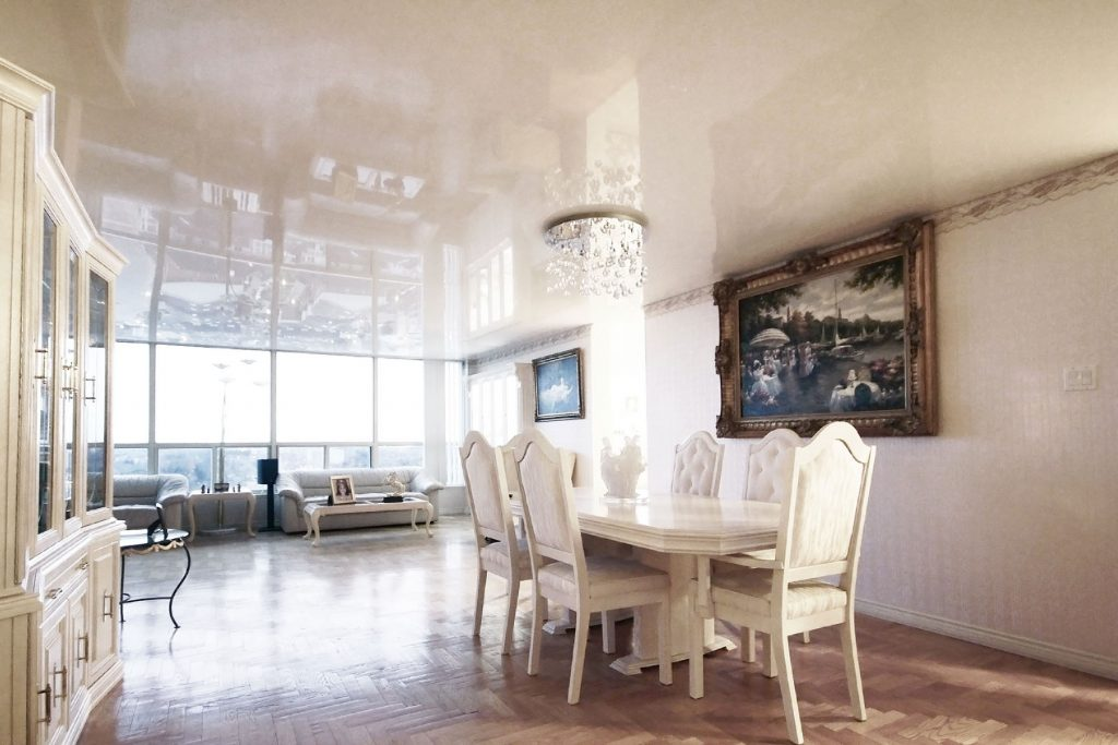 Dining room with reflective stretch ceiling in condo apartment by laqfoil