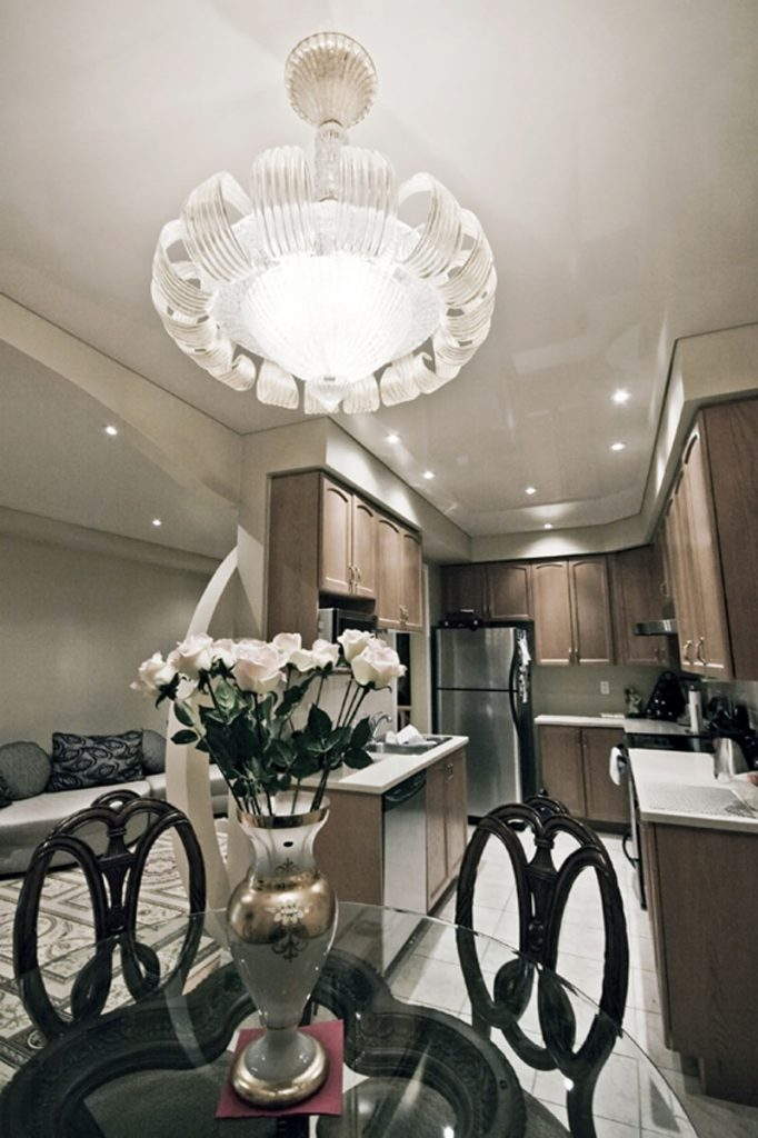 Kitchen & Dining white reflective stretch ceiling and brown cabinets