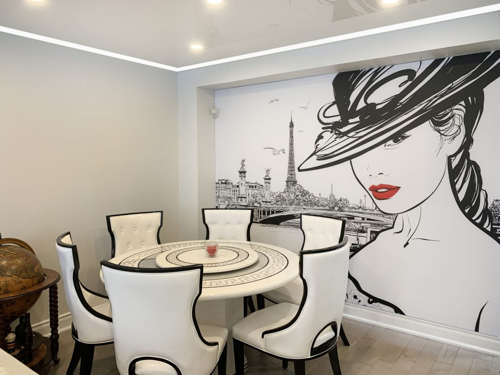 modern dining room with reflective stretch ceiling and printed wall murals by laqfoil