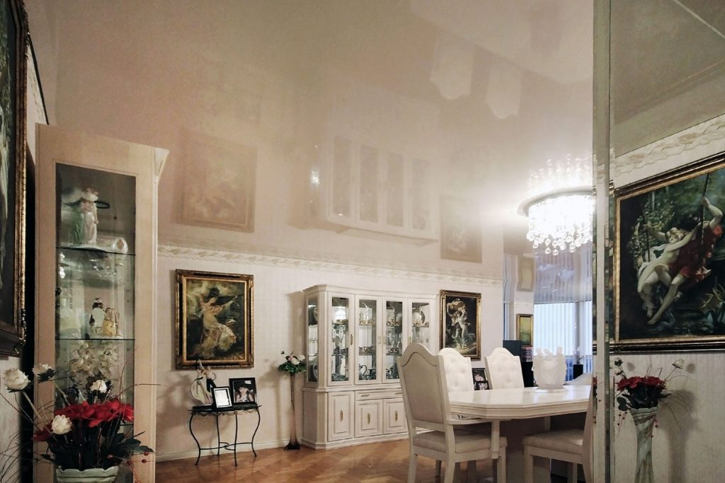 beige high gloss stretch ceiling in dining area