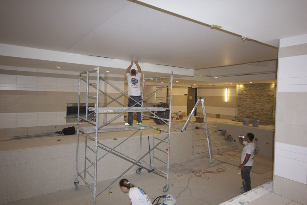 Laqfiol team working on reflective ceiling
