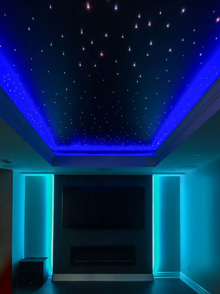 back lit walls and 3d stretch ceiling with blue backlit