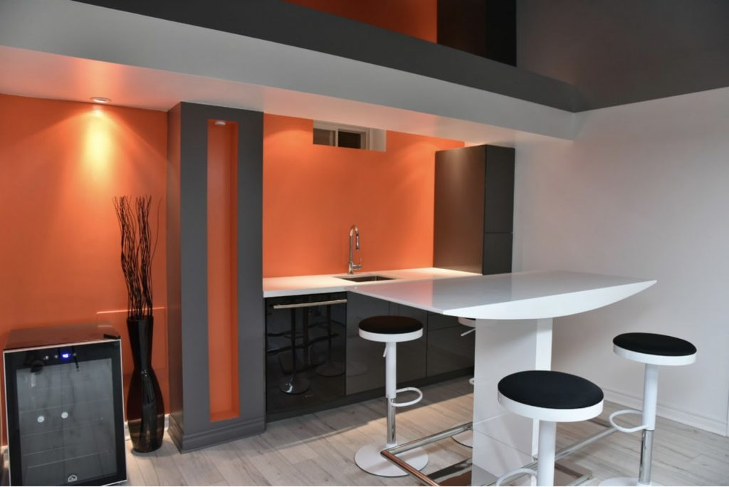 basement low ceiling with orange custom wall cover