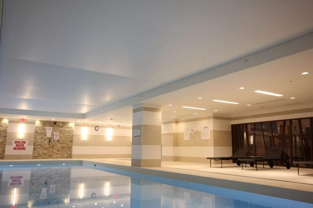 amazing stretch ceiling with Linear Lights in custom swimming pool