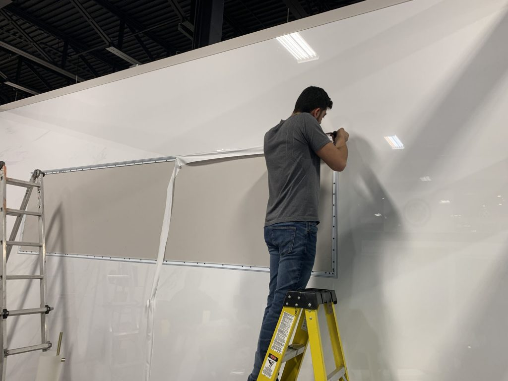 laqfoil team preparing wall for custom banner Vancouver