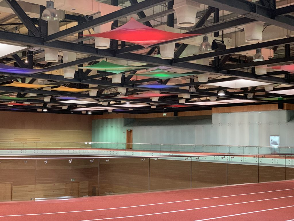 multi color modular structure ceiling in sport hallway