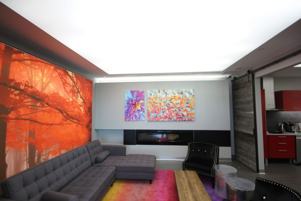 custom back lit reflective ceiling and wall mural in luxury office room