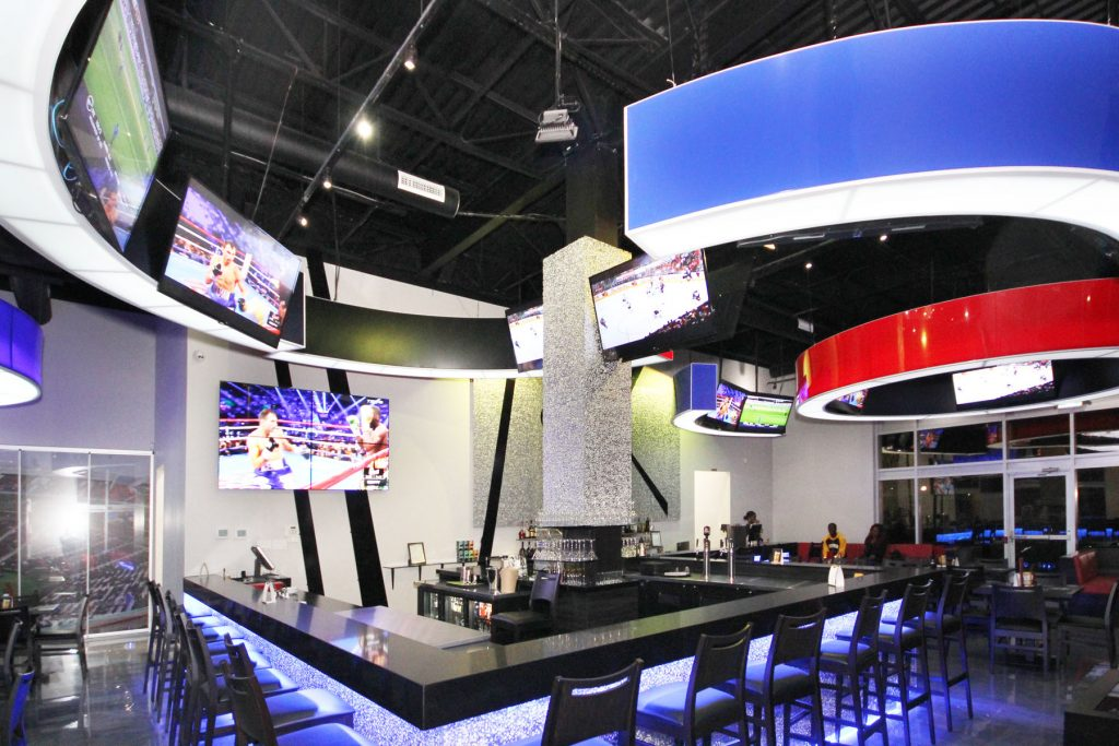 luxury sport bar with back lit bar and multi color modular structure