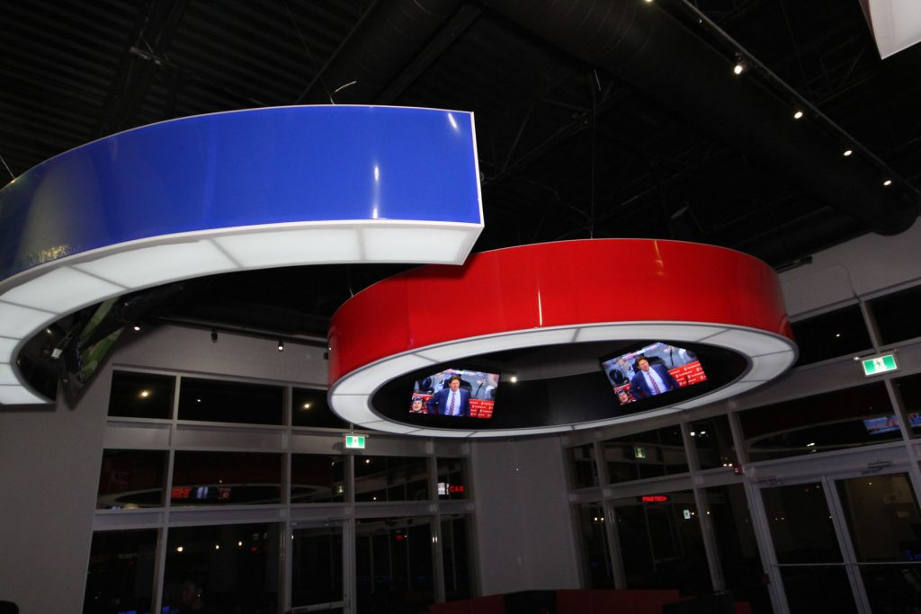blue and red multilevel modular structures in custom sport bar Toronto