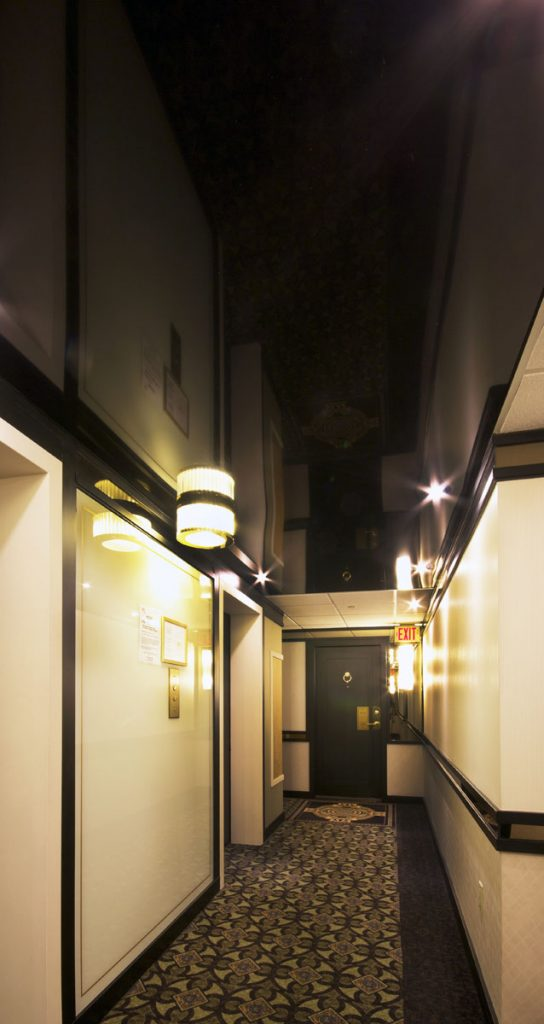 reflective black stretch ceiling in condominiums hallway