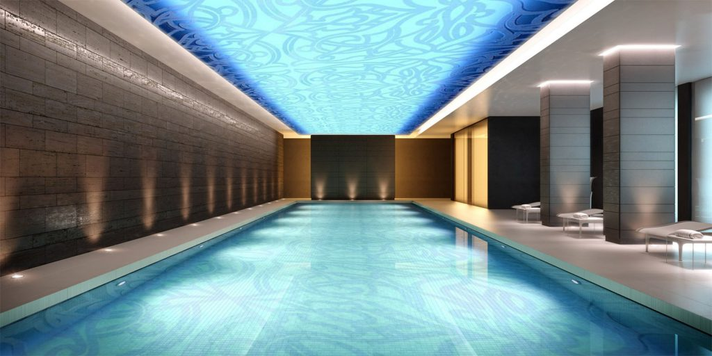 blue backlit gloss stretch ceiling over swimming pool