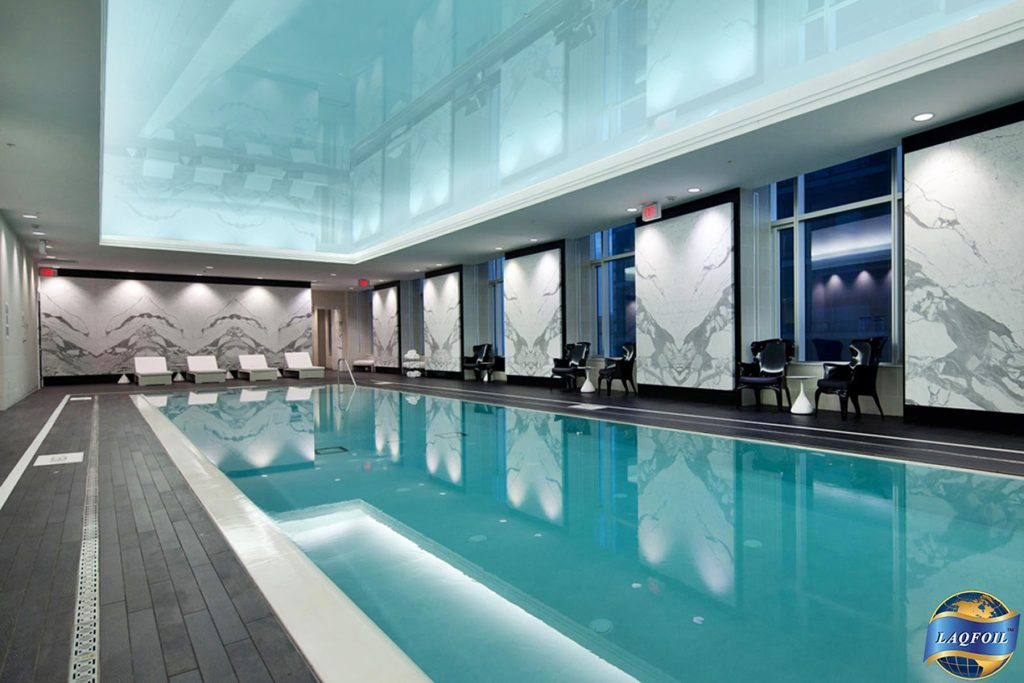 swimming pool with backlit high gloss stretch ceiling