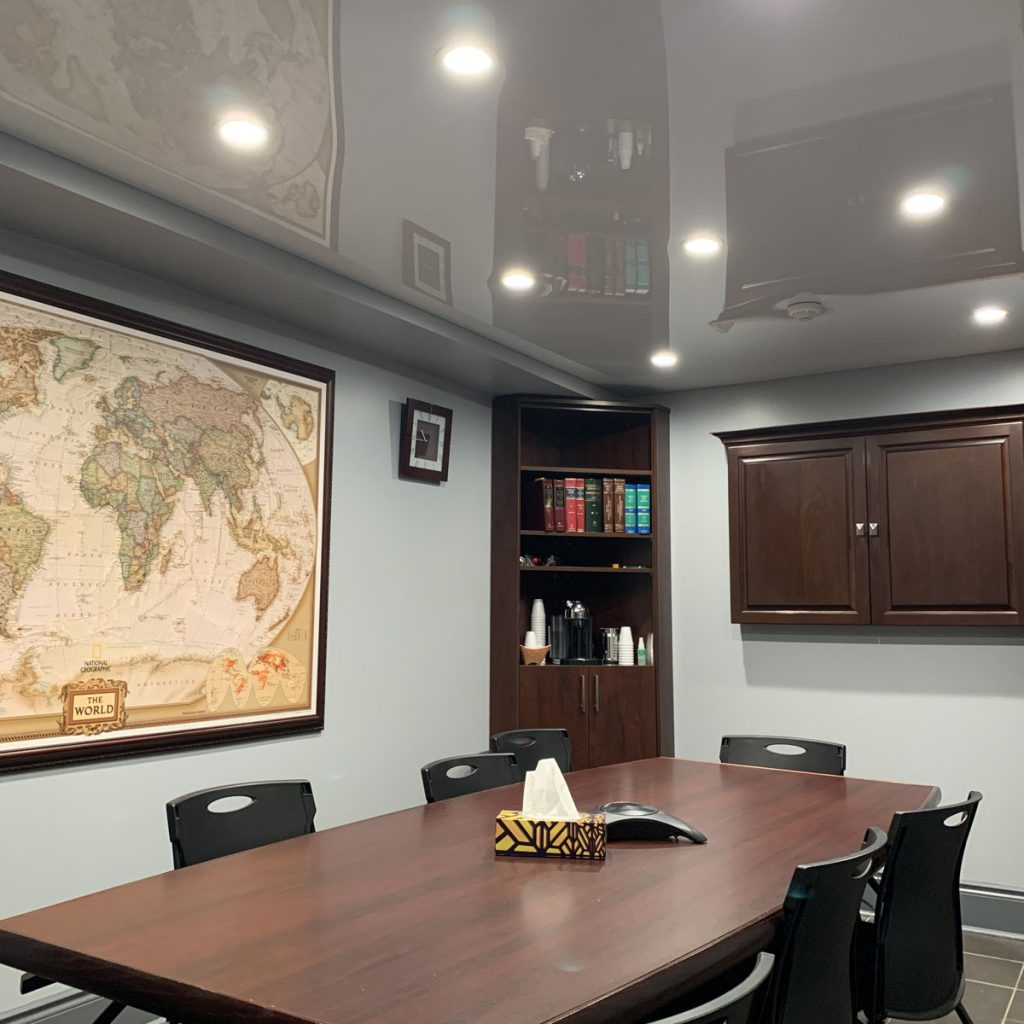 meeting room with translucent stretch ceiling and pot lights