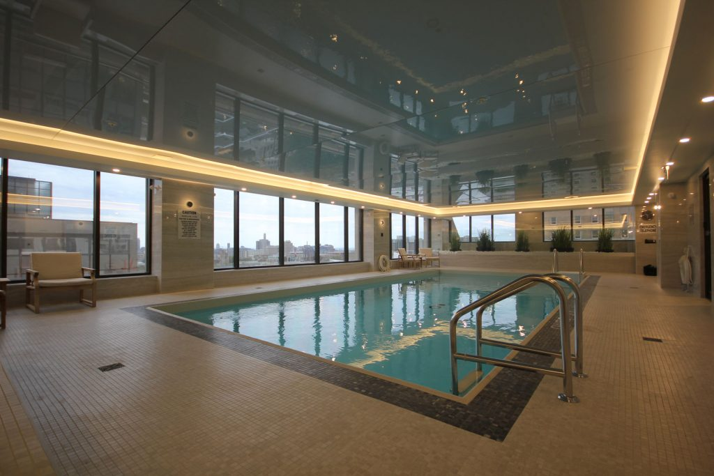 luxury swimming pool with orange custom backlit stretch ceiling in renaissance plaza