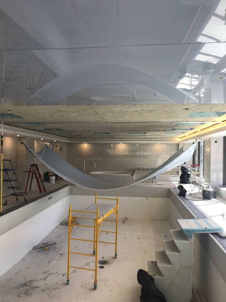 laqfoil team installing stretch ceiling swimming pool toronto