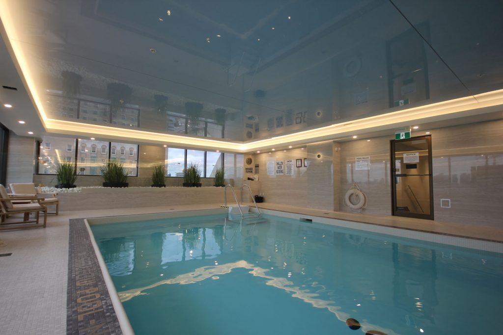 high gloss stretch ceiling in custom swimming pool