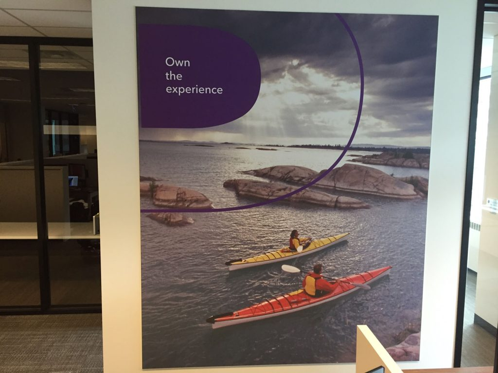 Rogers own the experience slogan on custom wall cover