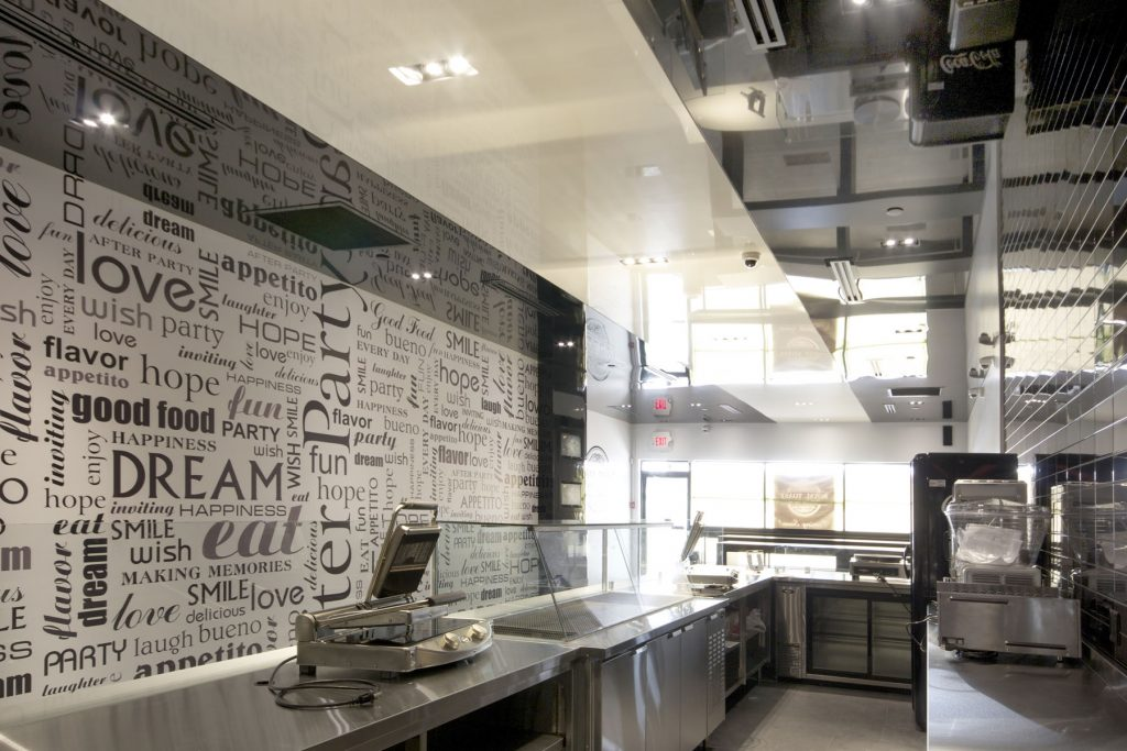 luxury cafe with reflective stretch ceiling and custom wall cover NYC