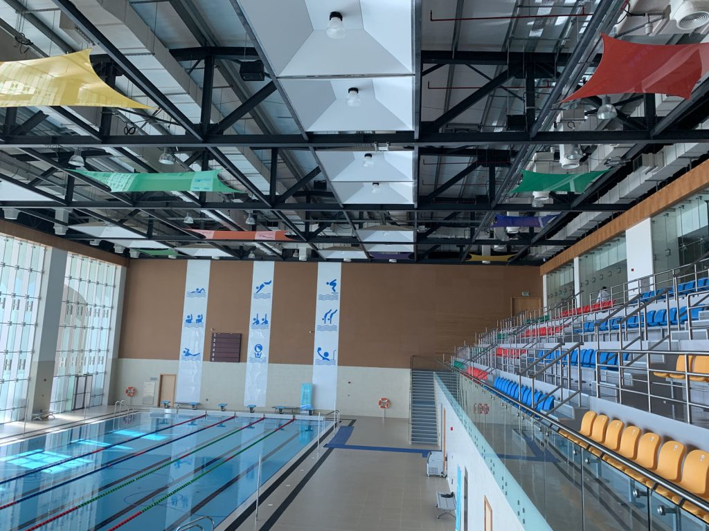 swimming pool area with luxury modular structure ceiling