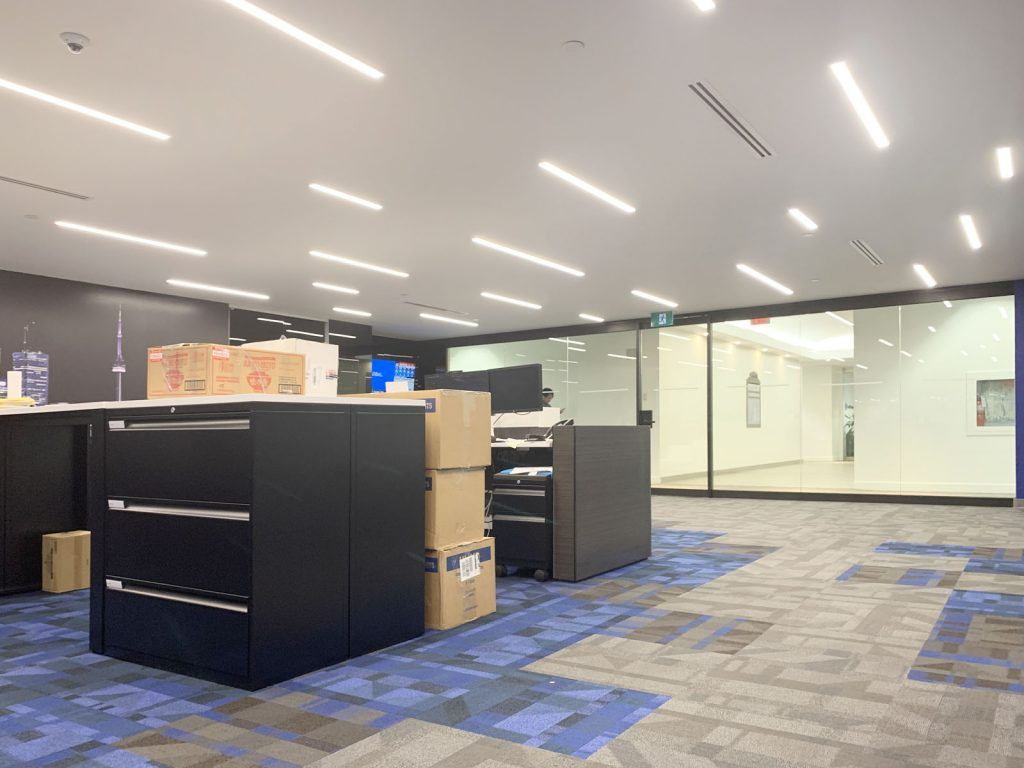 amazing office with Linear Lights Ceilings and custom wall cover canada