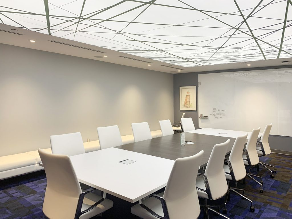 conference room with backlit stretch ceiling