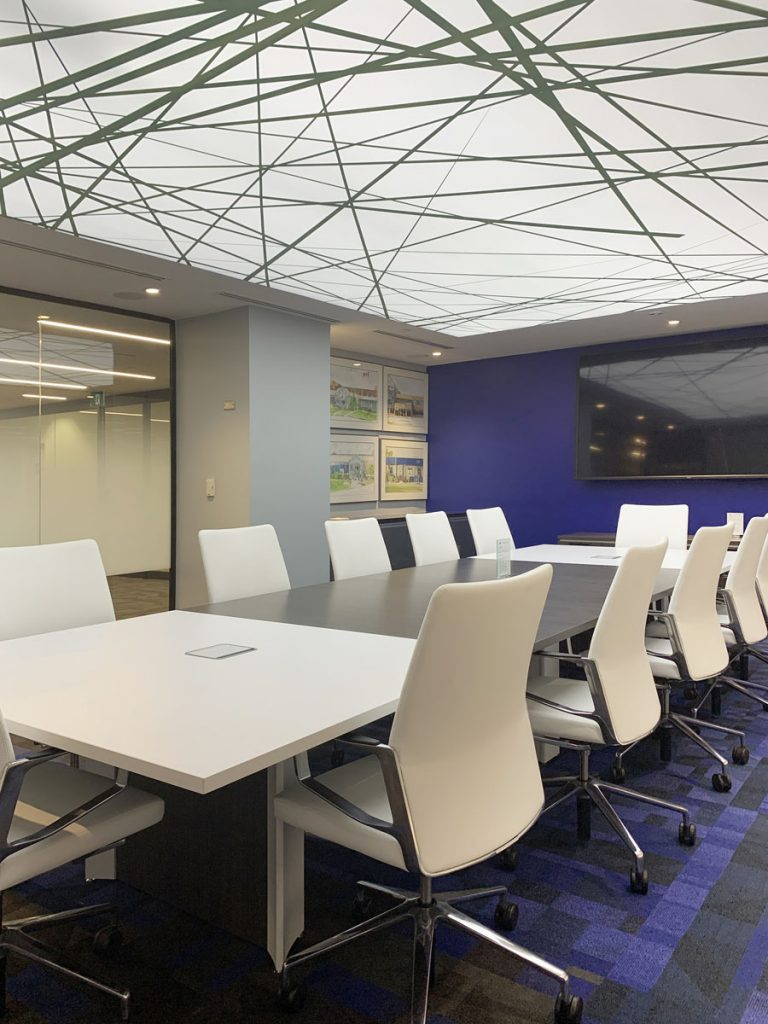 office with blue wallpaper and reflective stretch ceiling by laqfoil