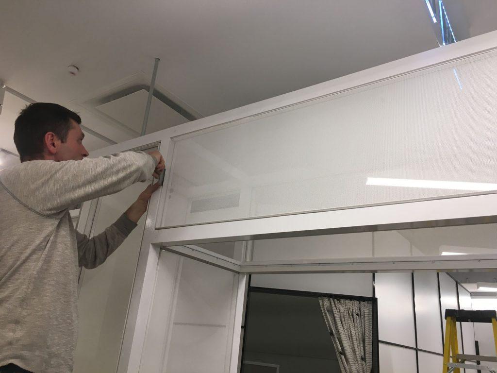 laqfoil team finishing installing glass wall