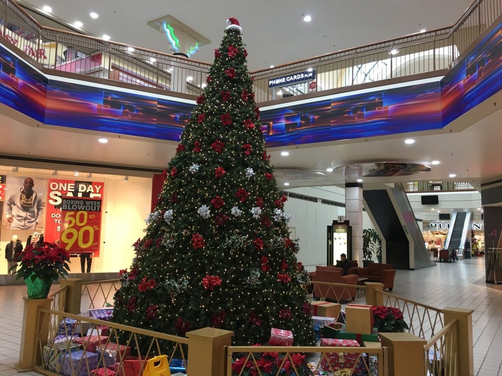 christmas tree in a mall and custom wall cover in the background canada