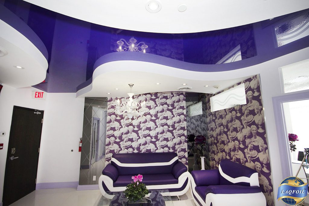 waiting room with custom wall cover and multilevel high gloss reflective ceiling