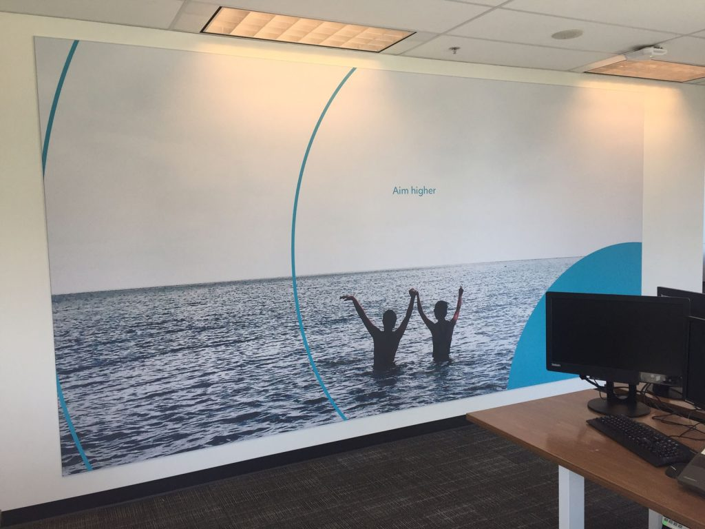 aim higher custom wall cover in rogers office