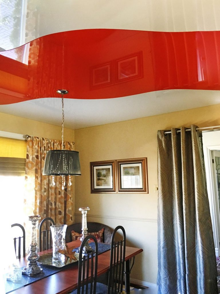 red high gloss stretch ceiling in luxury living room