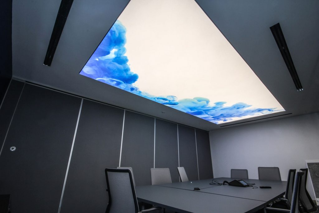 luxury office with back lit stretch ceiling glossy