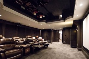 basement home theater with multilevel black stretch ceiling denmark
