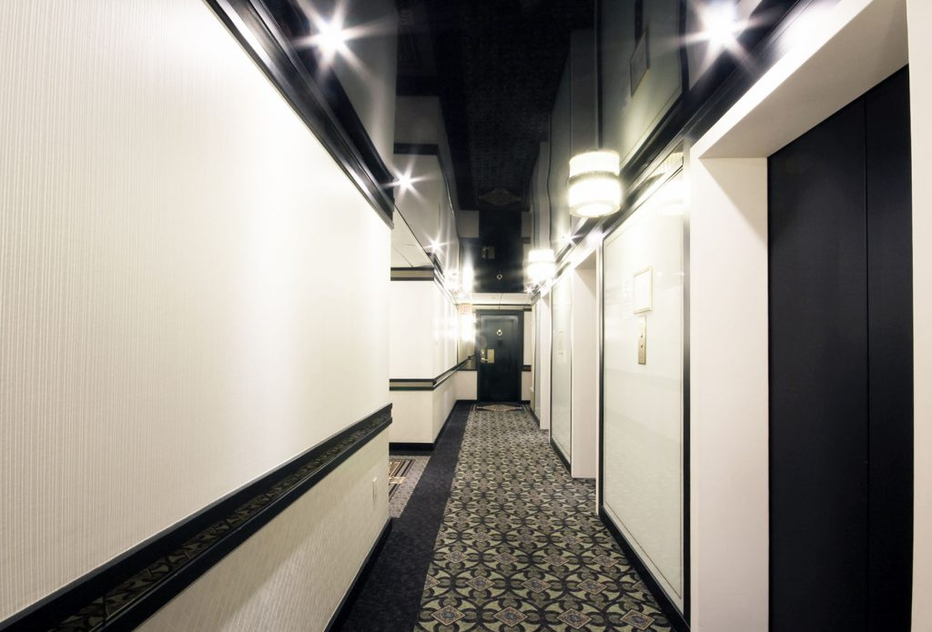 condo building hallway with black reflective stretch ceiling