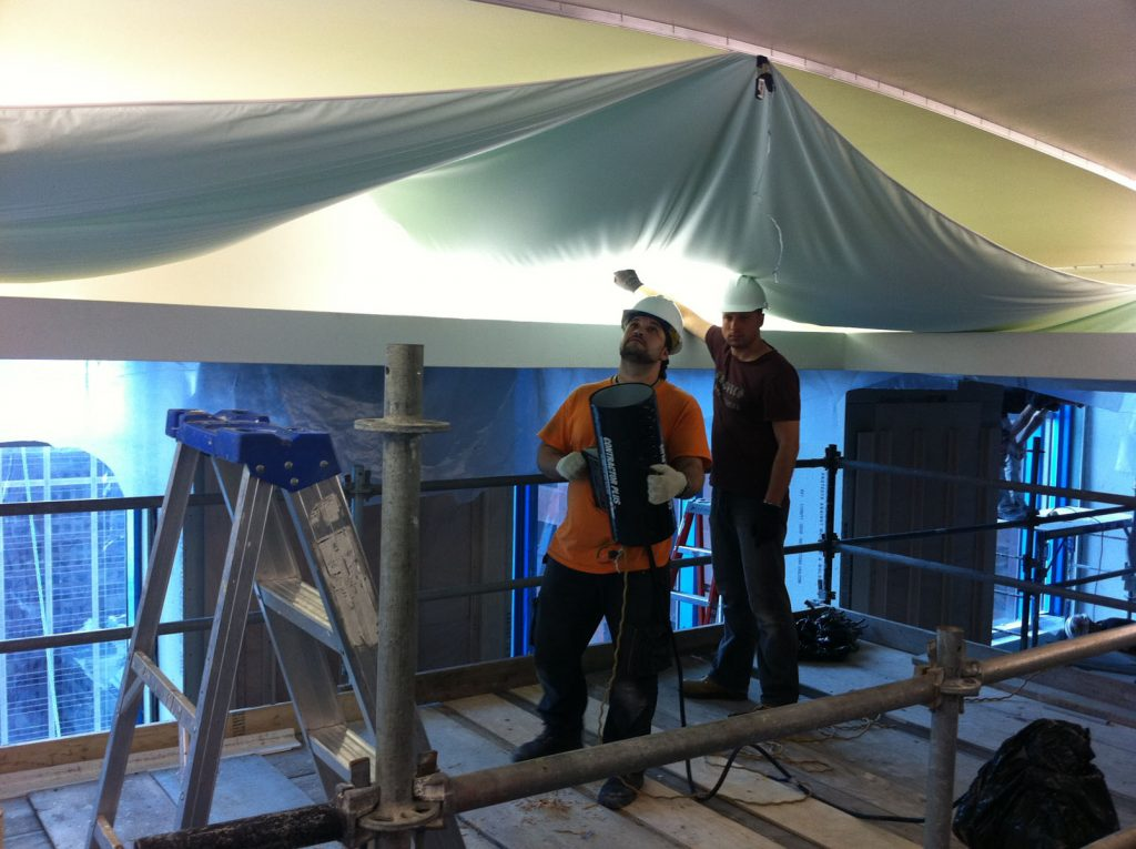 laqfoil team heating stretch fabric for application on the ceiling