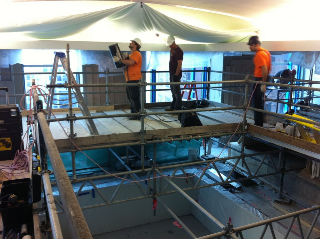 preparing stretch fabric for installation in pool area in hotel