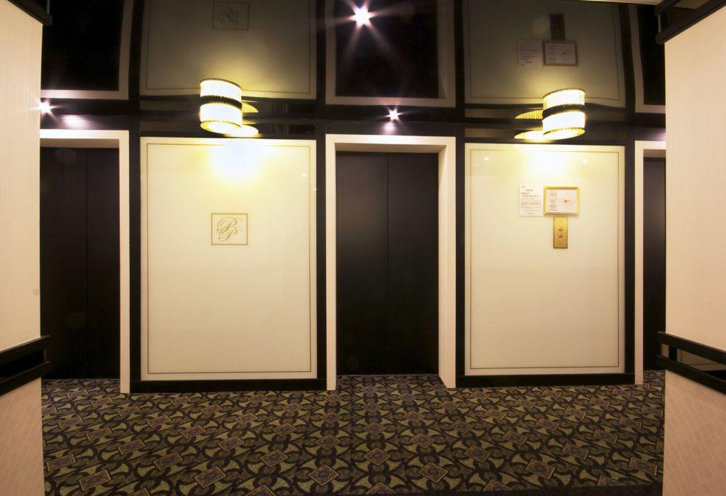 high gloss stretch ceiling with potlights in custom hallway