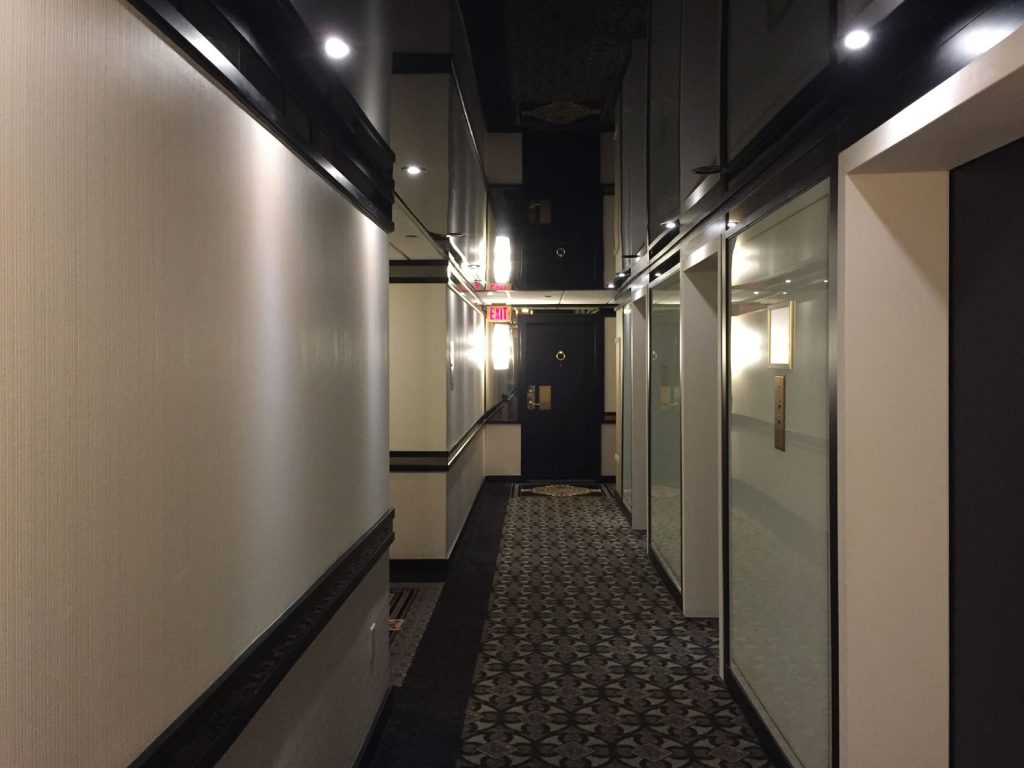 condo building with luxury reflective stretch ceiling in the hallway USA