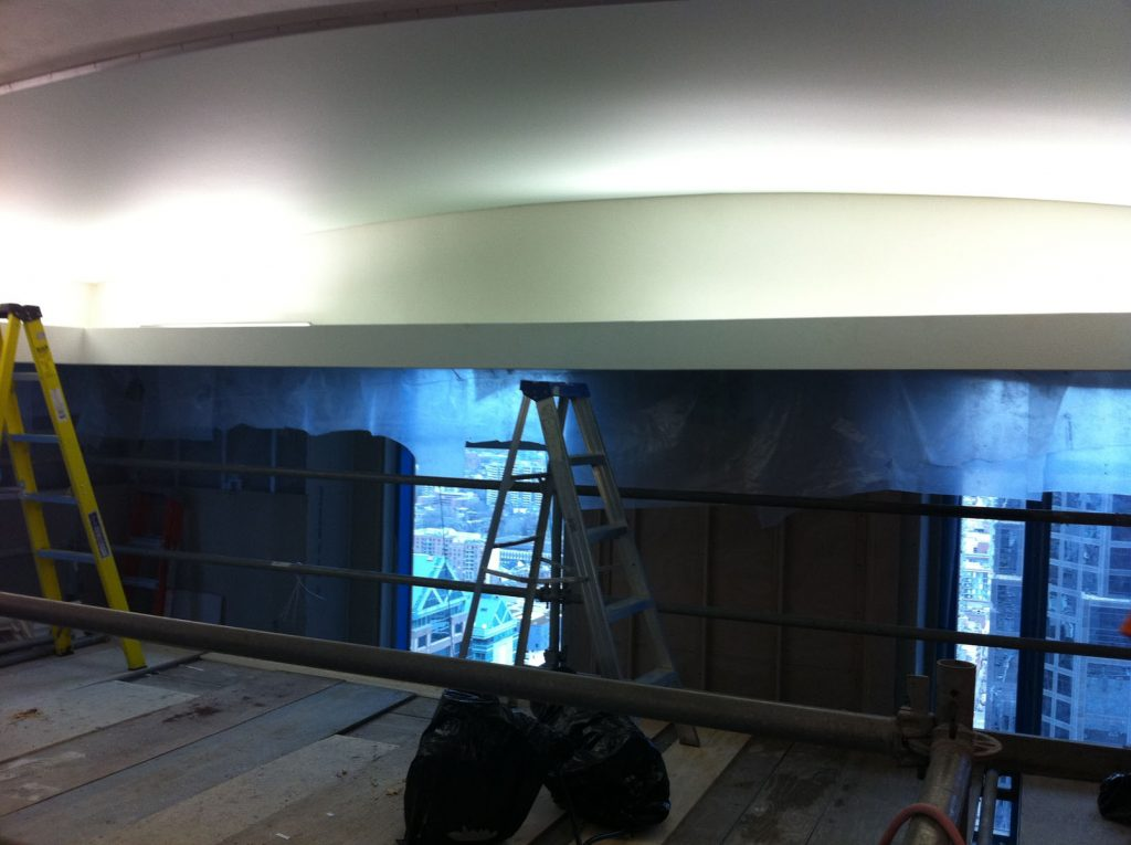 in progress of installing reflective stretch ceiling in swimming pool