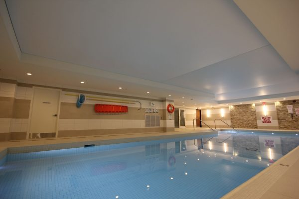 swimming pool area with luxury stretch ceiling vancouver