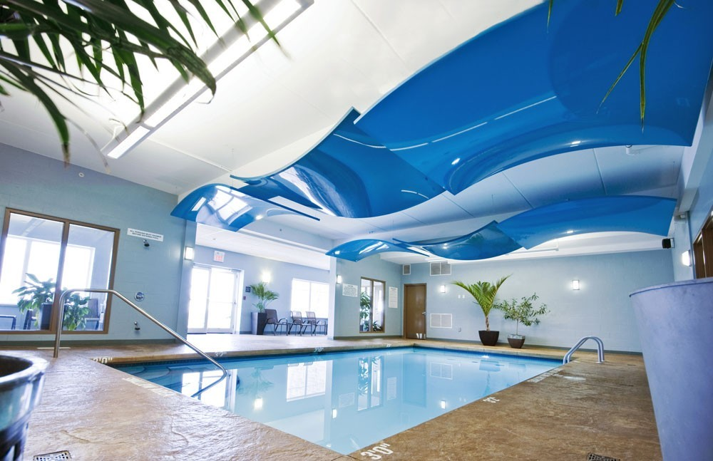 hotel swimming pool with custom blue modular structures UK