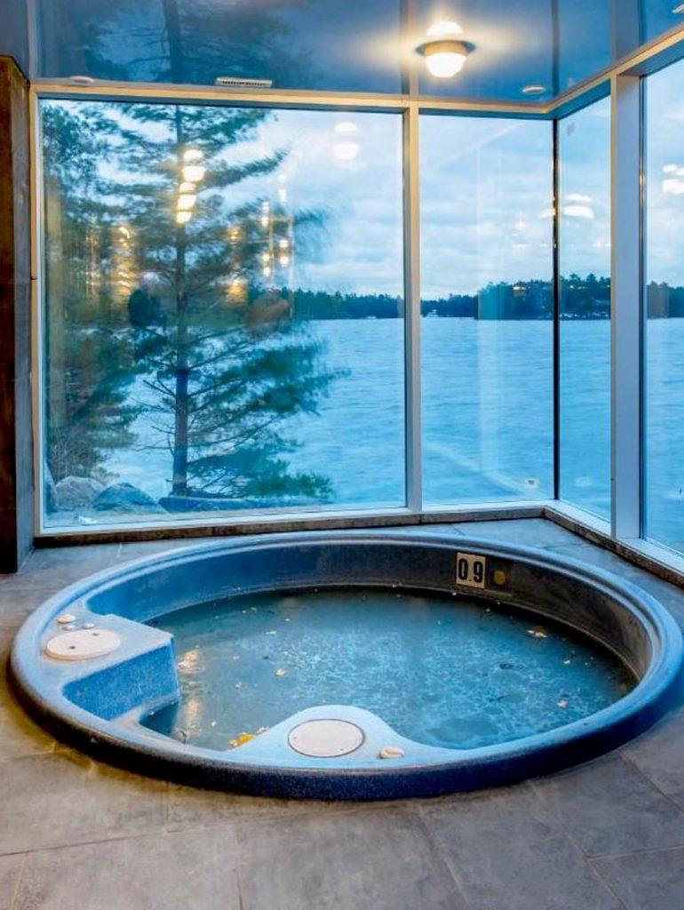 jacuzzi bathtub room with blue stretch ceiling glossy