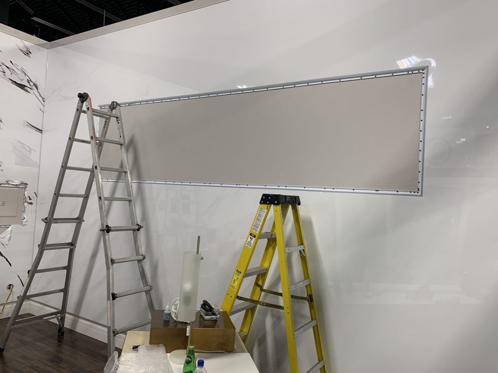 laqfoil team install custom wall cover on high gloss stretch ceiling