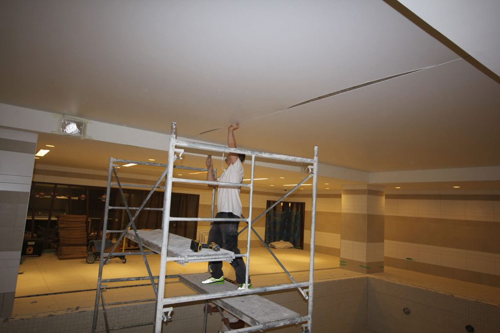 laqfoil team installing stretch ceiling in imperial plaza swimming pool