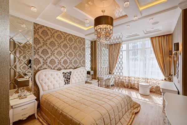 luxury bedroom with amazing custom wall cover and multilevel orange back lit reflective ceiling