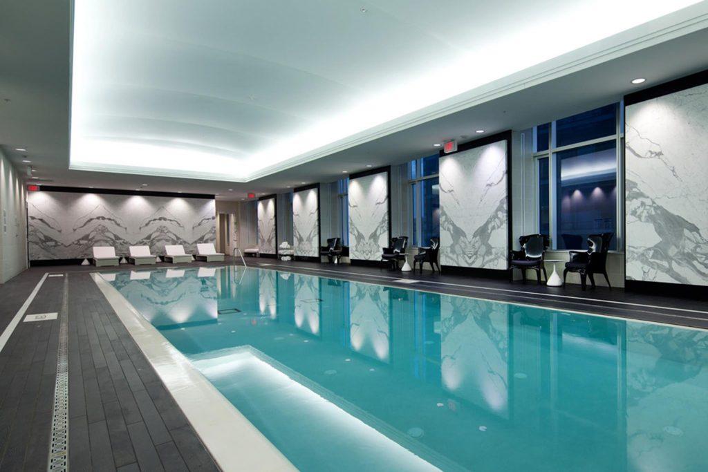 back lit stretch ceiling mirror effect in custom swimming pool